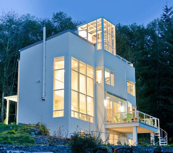 Modern eco-home with fireman's pole for fun; house uses passive solar energy and has solar chimney for natural ventilation, motorized solar shade, insulated concrete form walls, geothermal heating, and radiant floor heat <3
