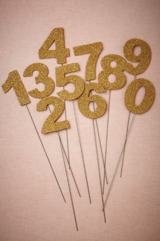these are so cute!! glittered table numbers. You could easily DIY these...