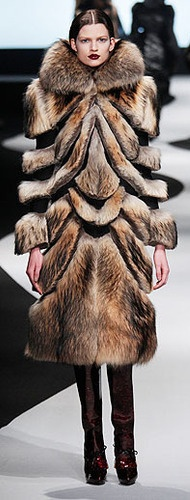 Viktor & Rolf 2012... an awful way to do fur, she looks like she's missing pieces of her body.