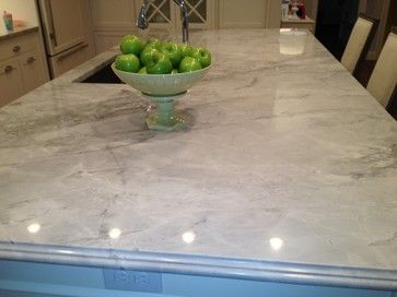 """Super White Quartzite""   I am DROOLING over these quartzite counters. They have the look of marble and the durability of granite."