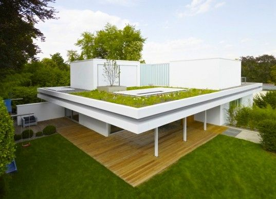 Cantilevered Green Roof Over A House In Germany