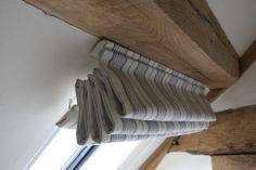 A Roman Blind fixed to the sloping ceiling in a barn conversion