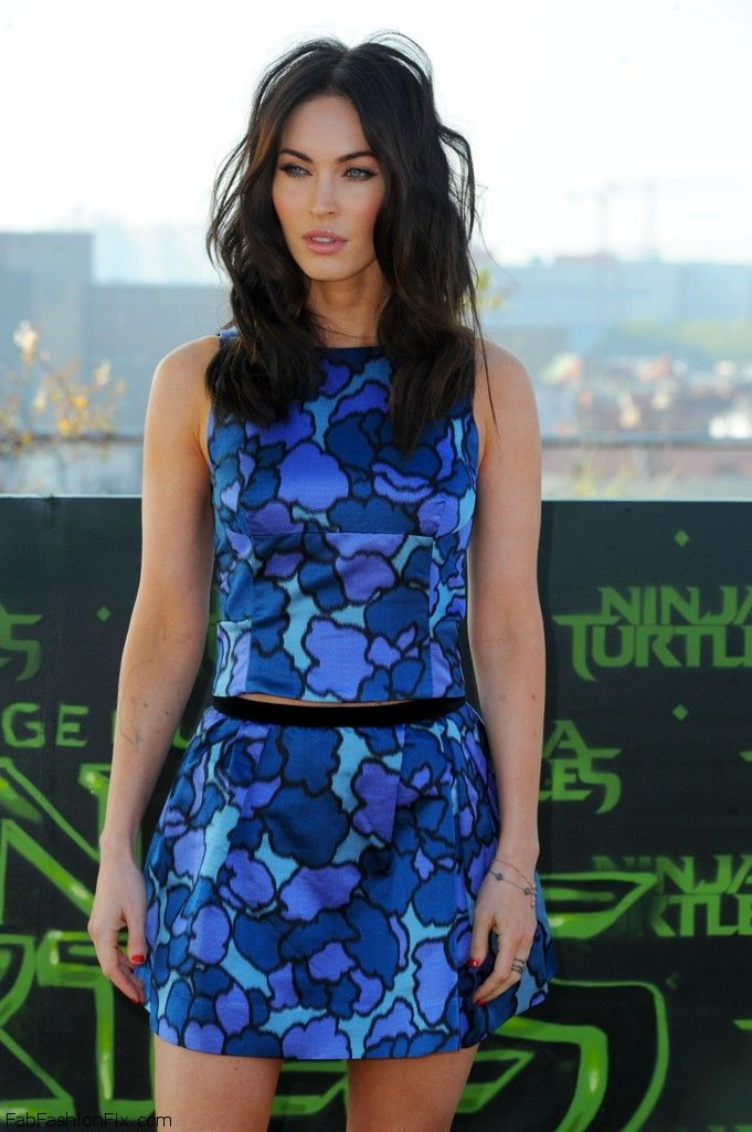 """Megan Fox dressed in Marc Jacobs colorful top and mini skirt at photocall for her latest movie """"Teenage Mutant Ninja Turtles"""" in Berlin (October 2014)."""