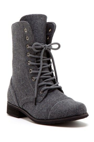"""Carrini Lace-Up Boot by Bucco Round, cap toe - Lace-up vamp - Side zip closure - Felt construction - Topstitch details - Approx. 7.25"""" shaft height, 11"""" opening circumference - Approx. 1.25"""" heel, 0.25"""" platform - Imported Materials Manmade upper and sole Color: Grey Felt $60.00"""