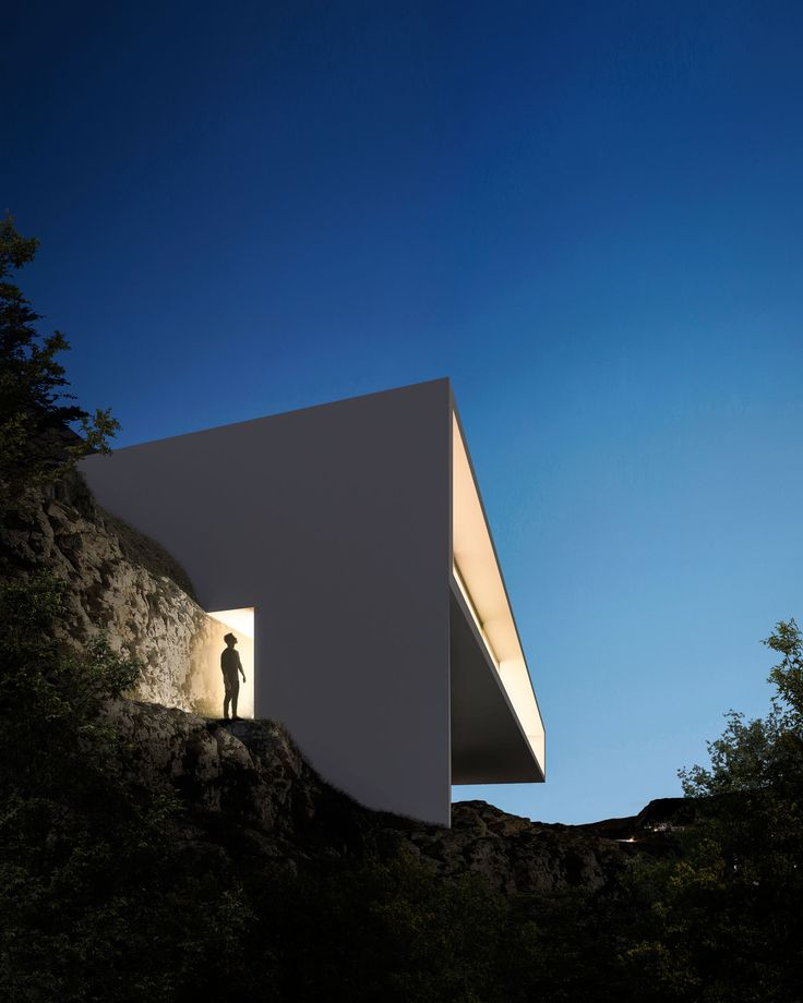 "Spanish firm Fran Silvestre Arquitectos designed the off-white angular form of this house so it would ""hang from the topography"" of the Hollywood Hills."