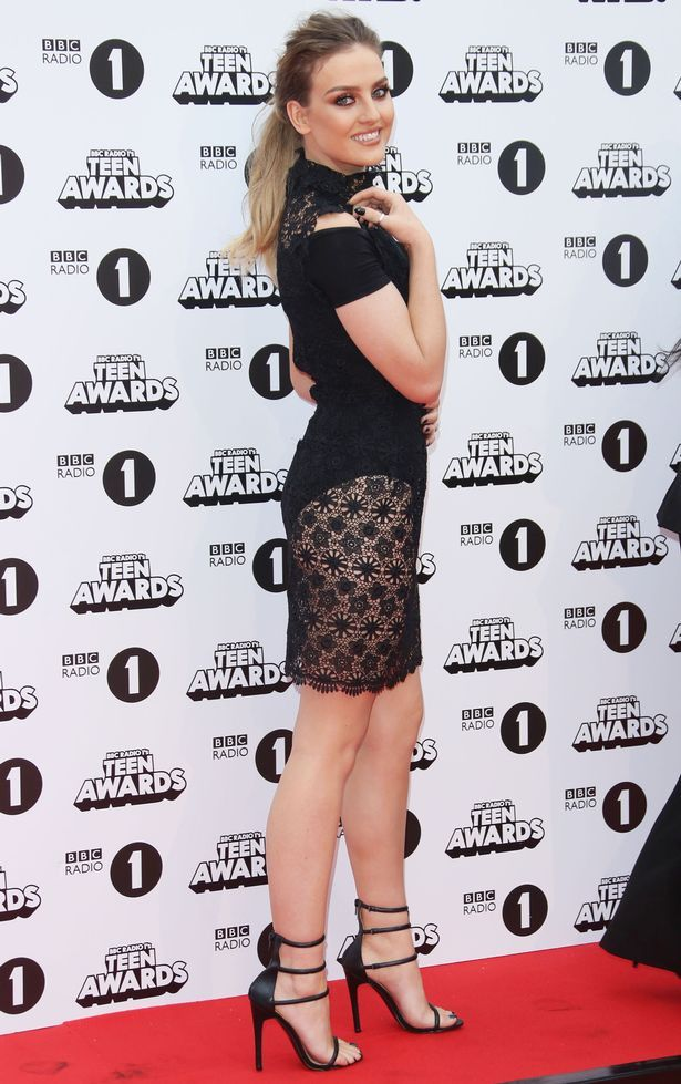 Little Mix were out to impress at the BBC Radio 1 Teen Awards on Sunday, with Perrie Edwards stealing the spotlight in this butt-flashing ensemble.  The 22-year-old beauty turned up the sex factor in the Gothic inspired black lace dress, over a skin-tight bodysuit which put her pert derriere on full display.  The blonde beauty finished off the vampish look with black, strappy heels and dramatic make-up.