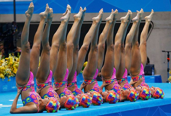Canada, sporting the competition's best hats as part of their Cirque du Soleil routine, pose poolside before finishing fourth