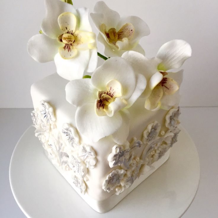 Bas relief cake with orchid sugarflowers