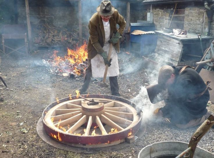 Tyring a wheel at Acton Scott Historic Working Farm in Shropshire. Photo taken by Anna Kavanagh & Lee Goddard.
