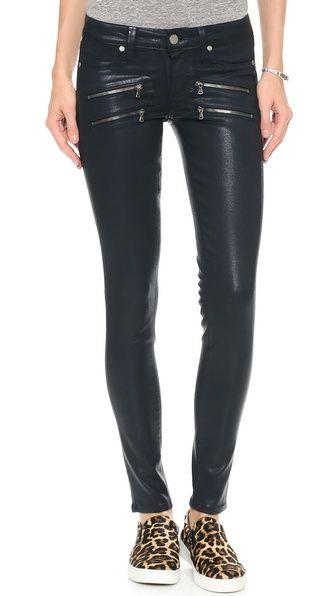 Black coated skinny jeans with zippers (no on the shoes)
