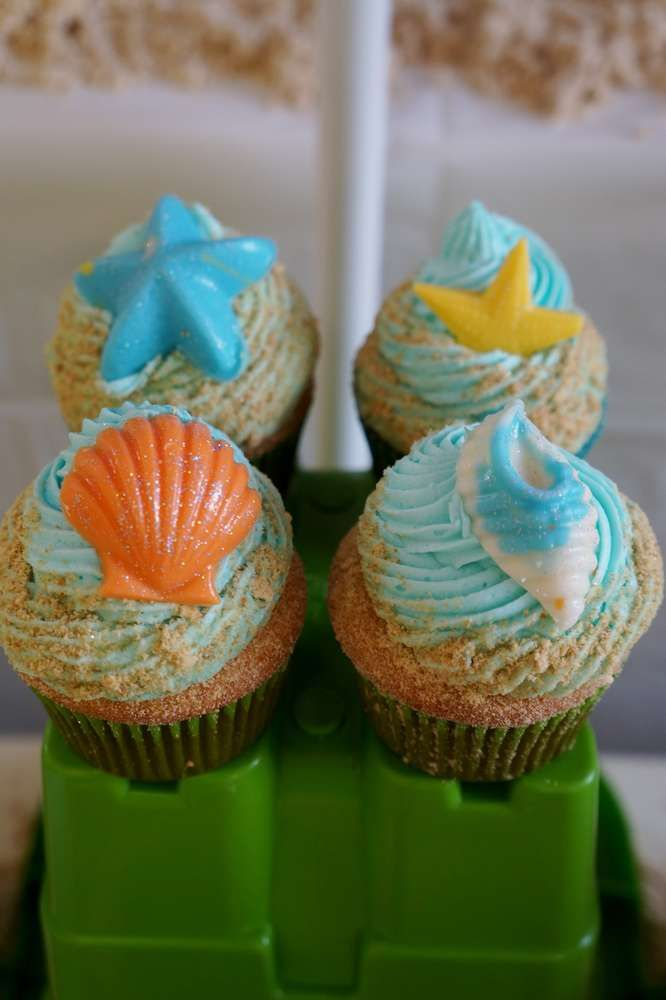 Seashell cupcakes at a Bubble Guppies birthday party! See more party planning ideas at CatchMyParty.com!