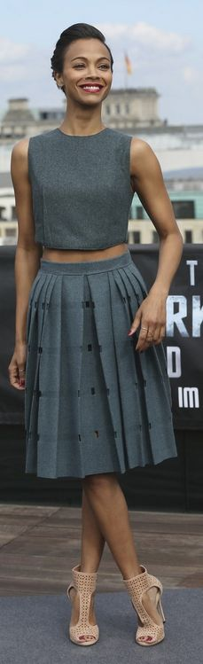 Who made Zoe Saldana's gray top, gray skirt, and nude sandals that she wore in Berlin on April 28, 2013? Shirt and skirt – Calvin Klein  Shoes – Jimmy Choo