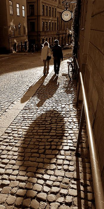 This was a moment I anticipated and waited for. I found this spot in Stockholm's historic Gamla Stan where the sun was casting a powerful shadow from a clock. I framed the image, and liked it, but felt something was missing. So, I set up and waited for something to happen. It didn't take long, and when this couple came by, it was just a matter of squeezing the trigger at the right moment. #cobblestone, #stockholm, #moment