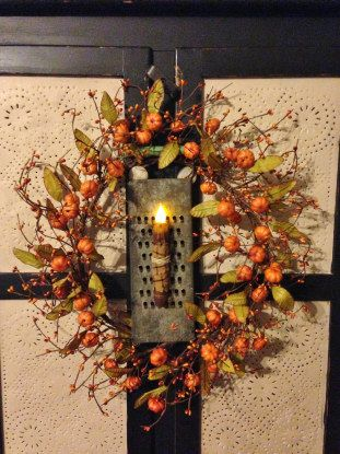Primitive Fall Pumpkin Wreath with Vintage Grater and Candle Light...perfect for a cupboard door! www.daisypatchprimitives.com