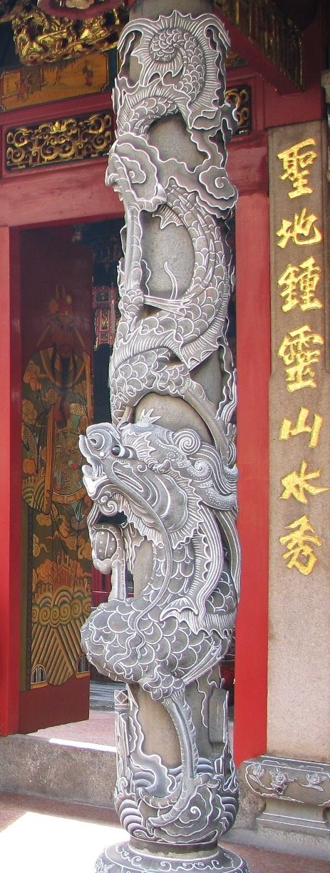 A beautifully sculpted pillar at the entrance to an old Chinese temple in Singapore.