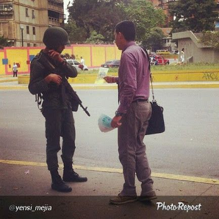 Street witnessing to a soldier in Caracas, Venezuela