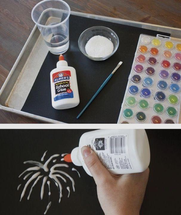 Leuk en makkelijk; vuurwerk! nodig: zwart papier, lijm, zout, waterverf en een penseel.