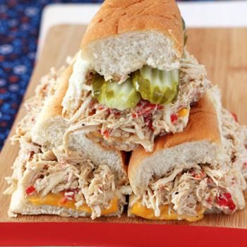 Slow-cooked, seasoned chicken breasts piled high on soft, toasted hoagie rolls with cheese, roasted red peppers, jalapeños, onions and pickles.