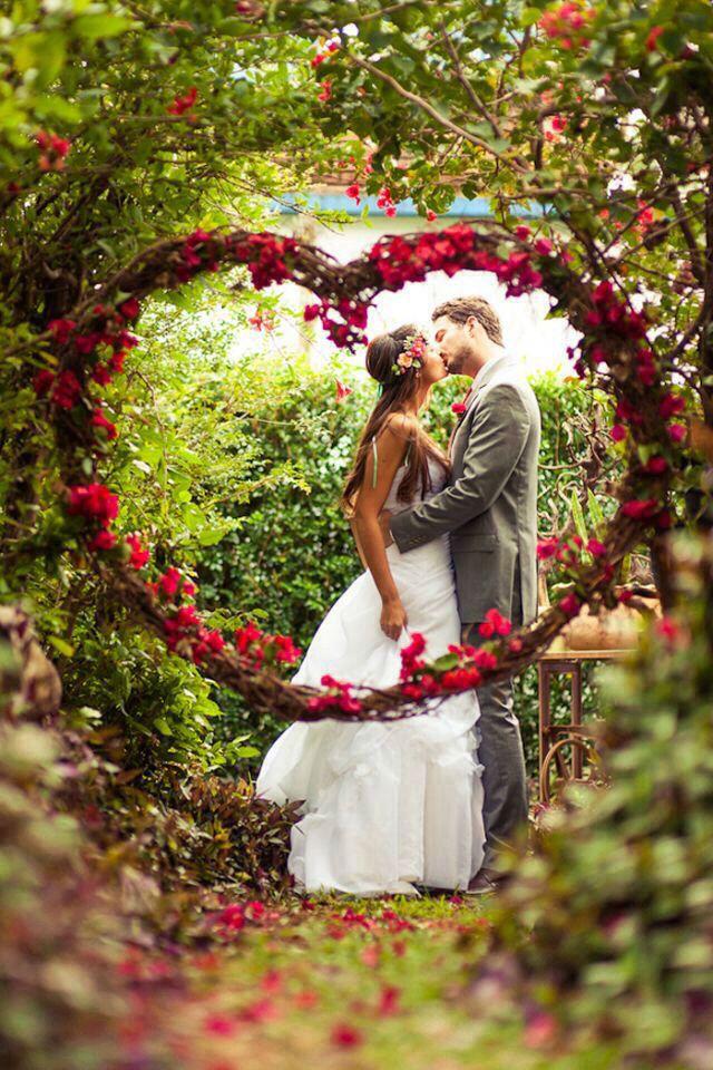 Hanging floral heart frame for wedding photo.  35 Totally Brilliant Garden Wedding Decoration Ideas