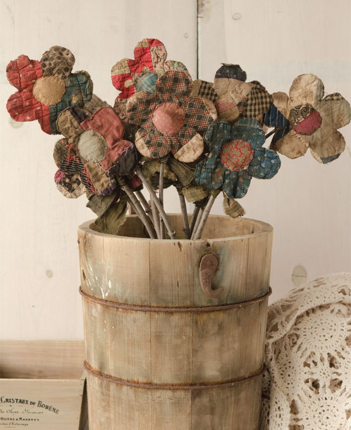 Ami Jones repurposed old quilts to create this rustic bouquet of flowers. | Prims