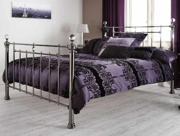 The Clara is a beautifully striking metal bed frame with a traditional design. Finished in black nickel, this bed frame oozes glamour with it's high head and foot ends and intricate detailing.