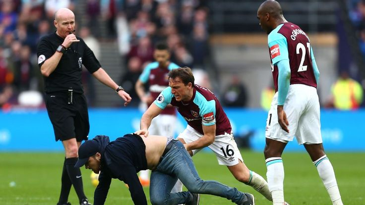 West Ham fans invade pitch, confront players and call for board to quit during Burnley game