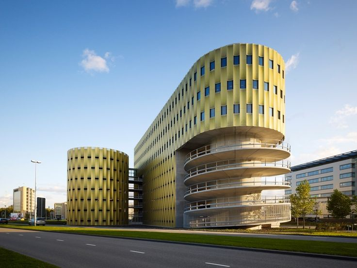 Parking Garage 'de Cope' - photo by Burg + Schuh, via archdaily;  designed by JHK Architecten;  built in Papendorf, Utrecht, The Netherlands in 2008;  the shorter building is office space, and the top three floors of the parking building is also office space;  the two units are connected by a crossway