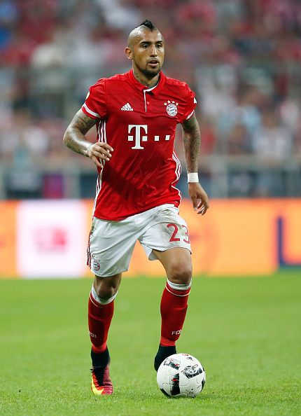 Arturo Vidal of Bayern Muenchen runs with the ball during the Bundesliga match between Bayern Muenchen and Werder Bremen at Allianz Arena on August...