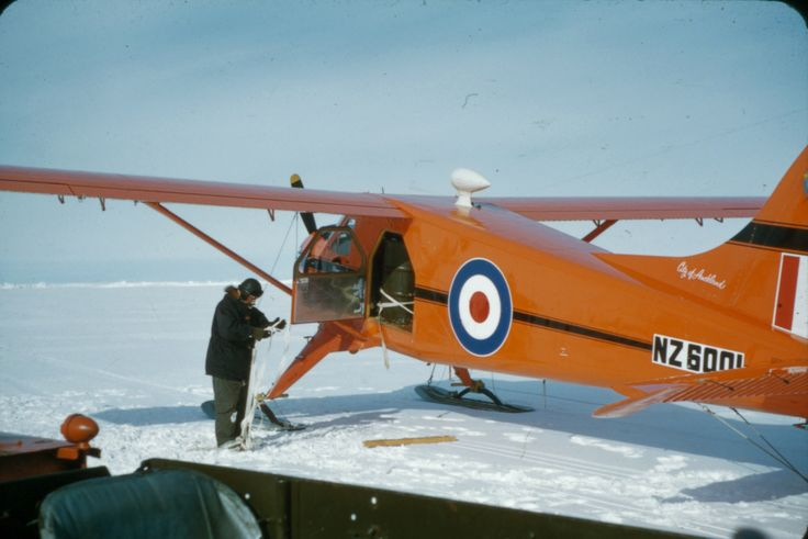 John Claydon checking strapping for petrol drums loaded unto DHC-2 Beaver NZ6001. Taken by Alun Breese whilst serving on RNZAF Antarctic Flight, Tran-Antarctic Expedition, October '57 - Feb '58. From the collection of the Air Force Museum of New Zealand.