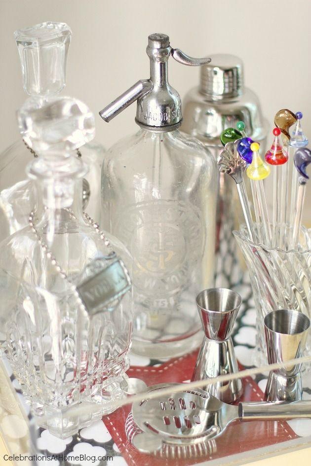 vintage seltzer bottle and decanters on bar cart