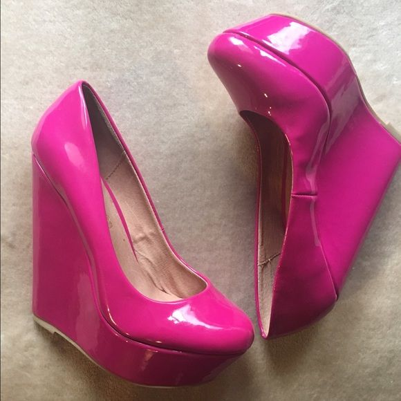 ALDO Hot Pink Wedges  ALDO size 7 patent leather wedge, genuine leather. Heel 5.5', platform 1.25'. Never been used, only tried on. Message me with any questions or interest  ALDO Shoes Wedges