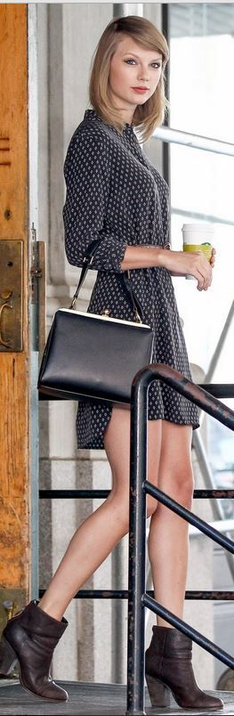 Black handbag, brown ankle boots, and print long sleeve dress