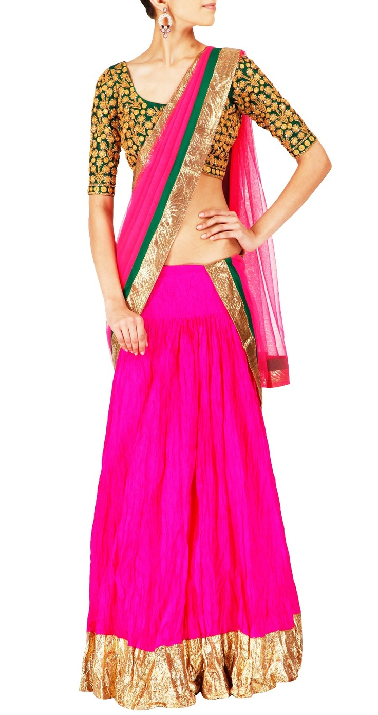 Pink crushed pure silk lehenga with thick gota border at the hem. It comes with a pure silk green blouse with embroidery and tikki work and a matching pink dupatta.
