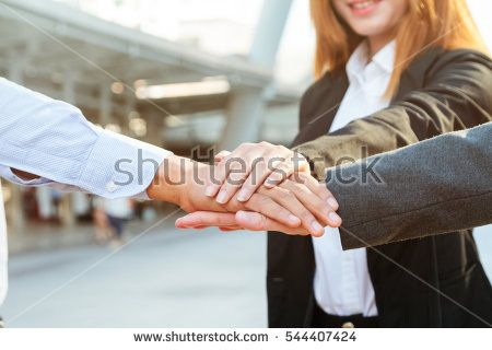 Group of business people joining hand together ,Group Teamwork Concept