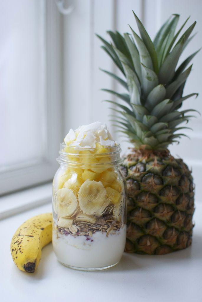 yummy breakfast : coconut yogurt, muesli, banana, pineapple and raw coconut chips