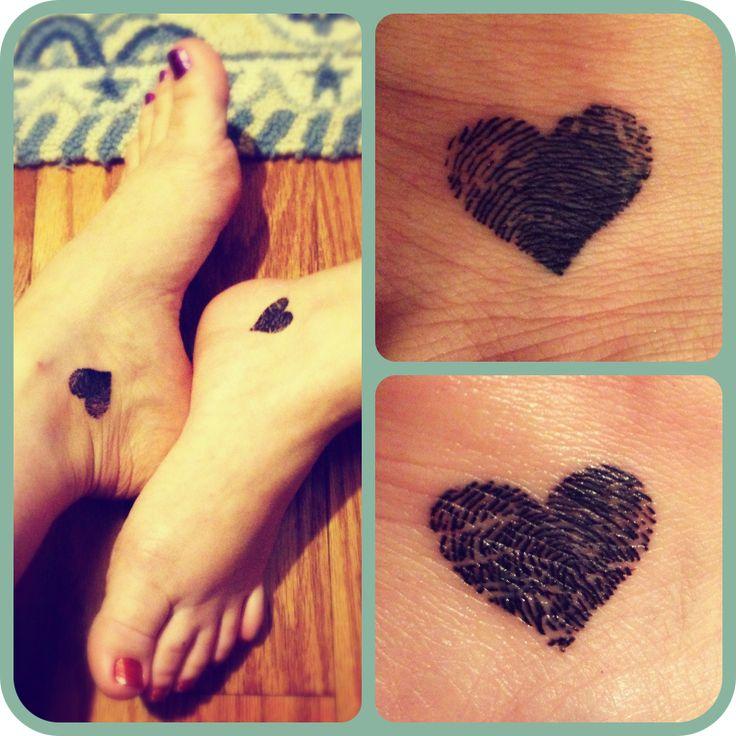 Matching sister fingerprint heart tattoos but I think I would do with my kids' fingerprints instead