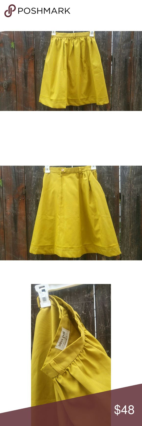 "True Vintage 50s Skirt Miss Pat of California 50s mustard yellow A-line skirt in amazing condition. It looks like it has been rehemmed at some point. I have added a wooden button because the old button was falling apart.  No size label, but it measures at 24"" waist, and 21"" from waist to hem. Hits just above the knee (I'm 5'4). I can't fit it anymore unfortunately, but I would say it is roughly a size 2-3. Vintage Skirts A-Line or Full"