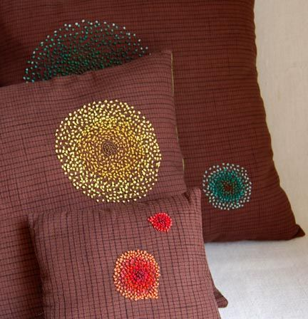 cute french knots on these pillows- so modern.