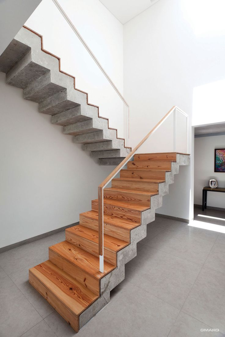 Amazing staircase design love the mix of concrete against the warm tones of the wood a house by estudio gmarq