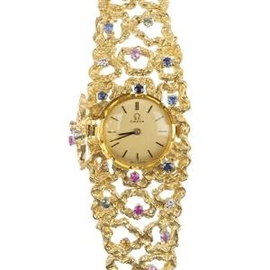 a lady's 1960s Omega 18ct gold gem-set watch