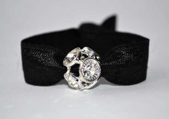 This elegant elastic hair tie has a beautiful crystal bead. Choose black or silver. This fancy hair tie is perfect for your holiday parties, but
