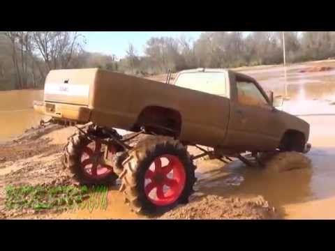 Mud Trucks and Bikinis Gone Crazy in Deep Slinging Mud Bog