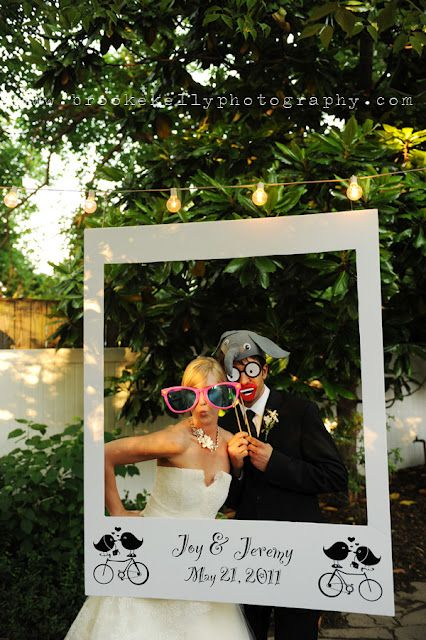 this is at a wedding, but would make a really cute photo booth for any party. Just put the name at the bottom, have some props and start shooting :) How fun!!