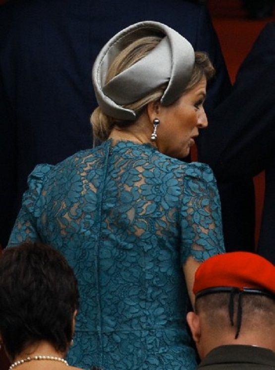 Queen Maxima of the Netherlands back details of her fascinator and lace dress as she enter the Presidential Palace during welcoming ceremony in Caracas, Venezuela, 23.11.13.