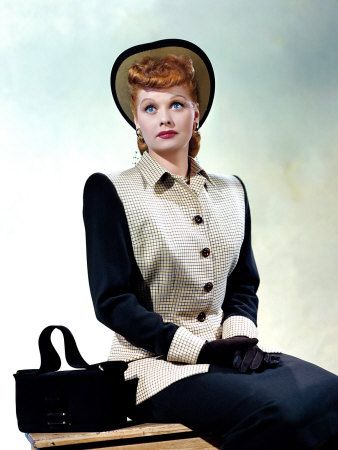 Lucy looking sophisticatedly lovely in a white and navy blue suit and matching accessories, 1940s.