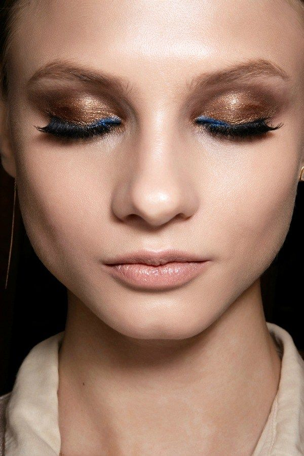 The stunning copper-y eye at Versace was taken to the next level thanks to a pop of electric blue in the inner corners. Finish by piling on the mascara and you're good to go! Try: Laura Mercier Metallic Crème Eye Colour in Burnished Copper and Lancôme Le Stylo Waterproof Long Lasting EyeLiner in Marine Chic