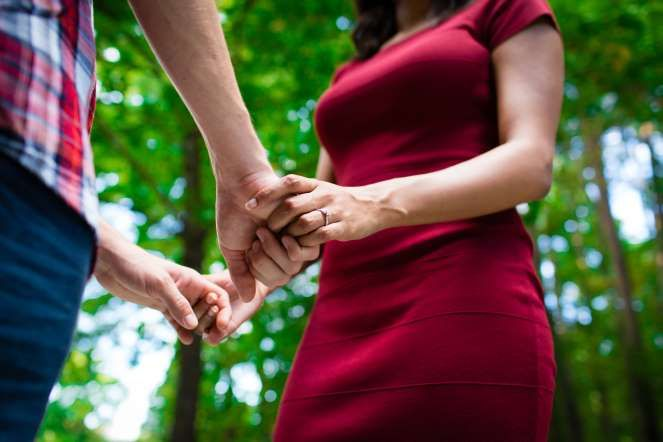 Engaged couple holding hands - Rick Lowe/Getty Images