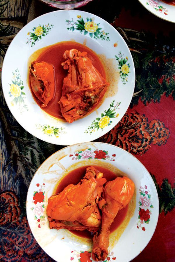 Marinated in a crimson achiote-and-citrus marinade and served with pickled onions, this chicken dish is eaten all over the Yucatán.