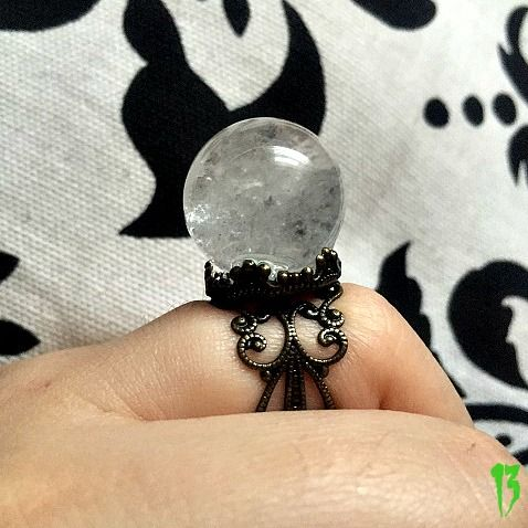 This is a beautiful genuine clear quartz crystal ball ring. adjustable and lead and nickel free.