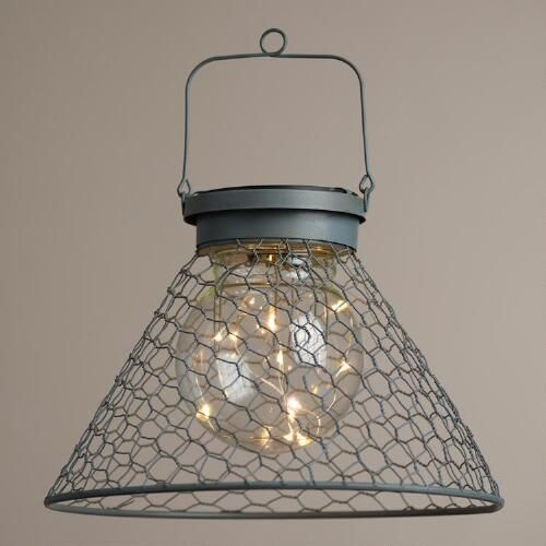 One of my favorite discoveries at WorldMarket.com: Antique Gray Wire Solar LED Lantern
